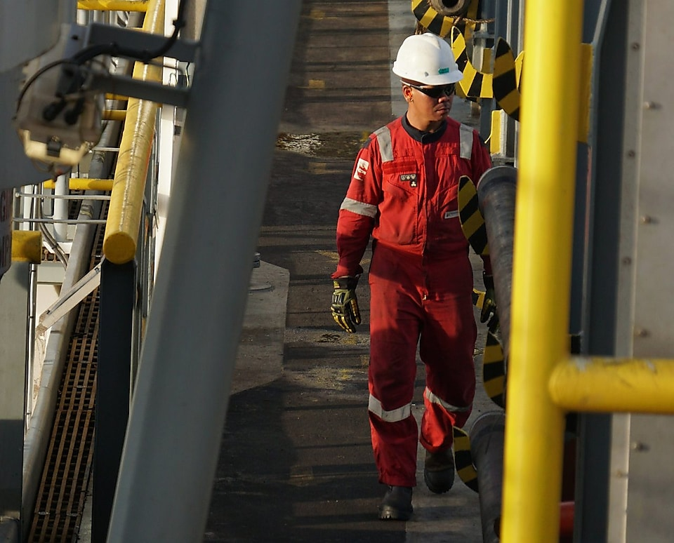 employee walking on malikai platform.jpg