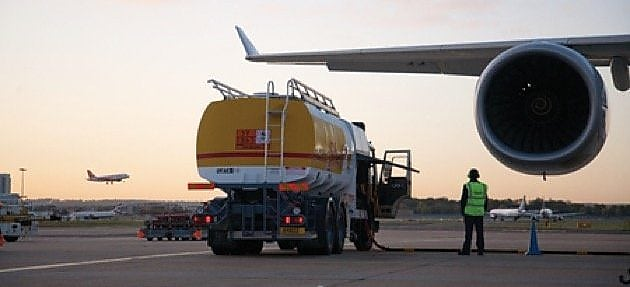 Shell fuel tanker by wing of Airbus A380 on tarmac
