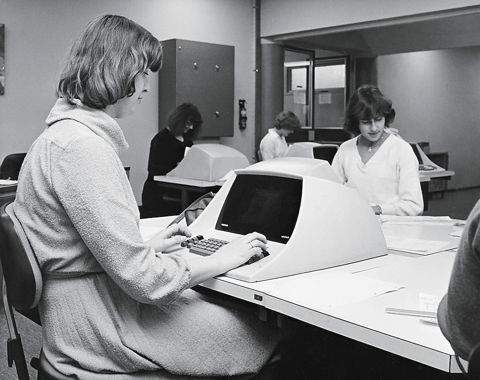 Women at desks working on computers