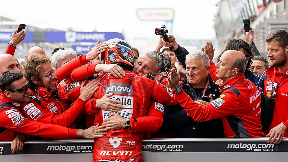 The Ducati team celebrates Danilo's podium in France