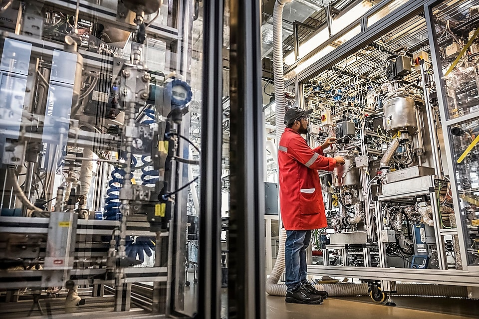 A worker monitors results of guard beds in a hydrogen plant