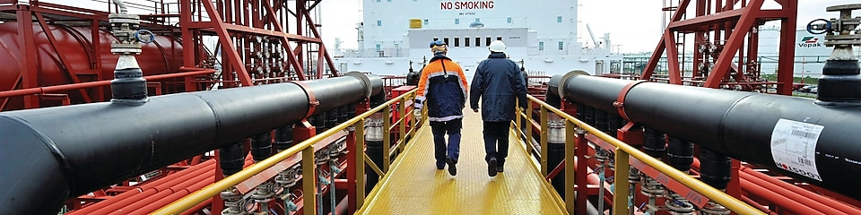 Shell employee walking along on a tanker
