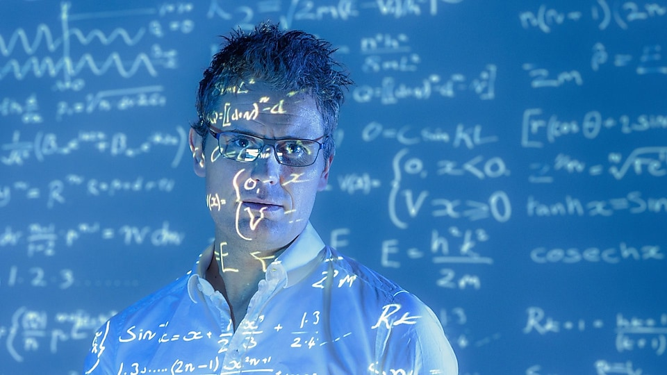 Scientific formulae projected on to face of scientist