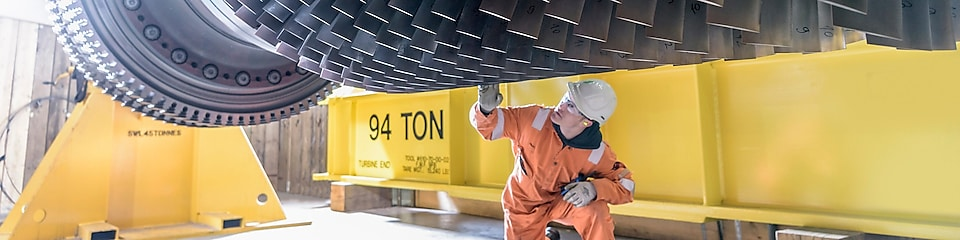 power-engineer-inspects-the-blades-of-an-industrial-turbine