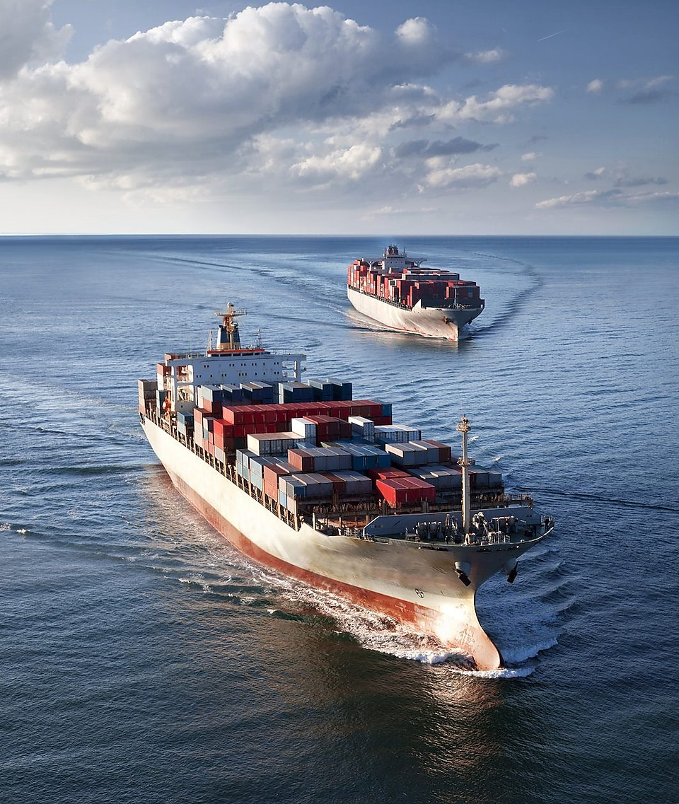 Two cargo vessels sailing in open sea