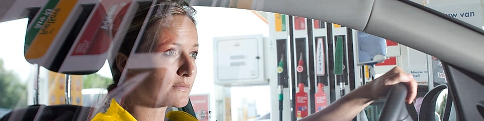 Woman in car on Shell forecourt