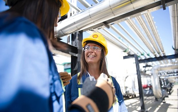 female engineer smiling at an operational site