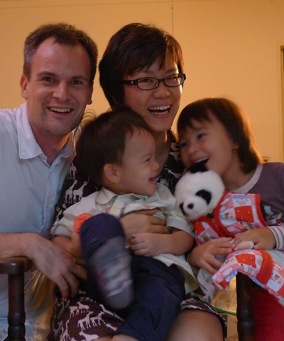 Shell employee Joyce Loh with her husband and two kids.