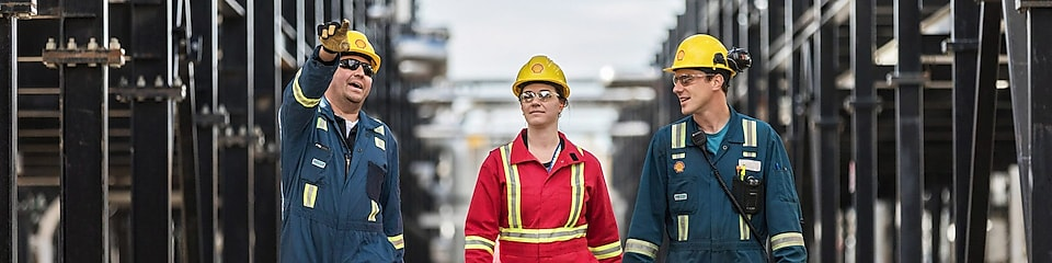 Shell engineers walking together at an operational site