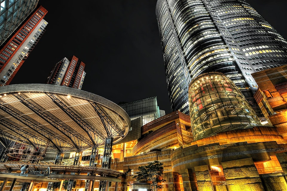 Low angle view of golden illuminated Roppongi Hills Mall building in Japan