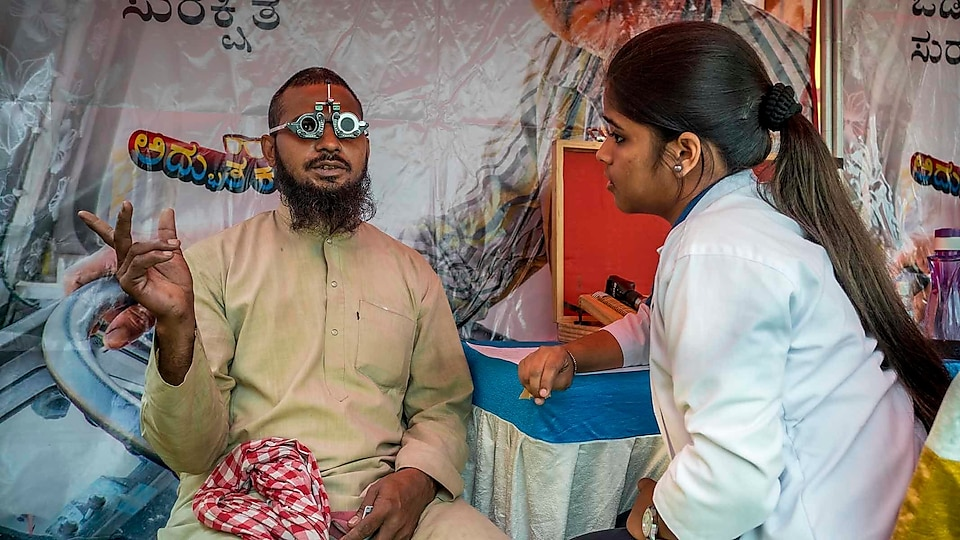 Aslam Malik, who has been driving a truck for 20 years, gets his vision checked at Bangalore