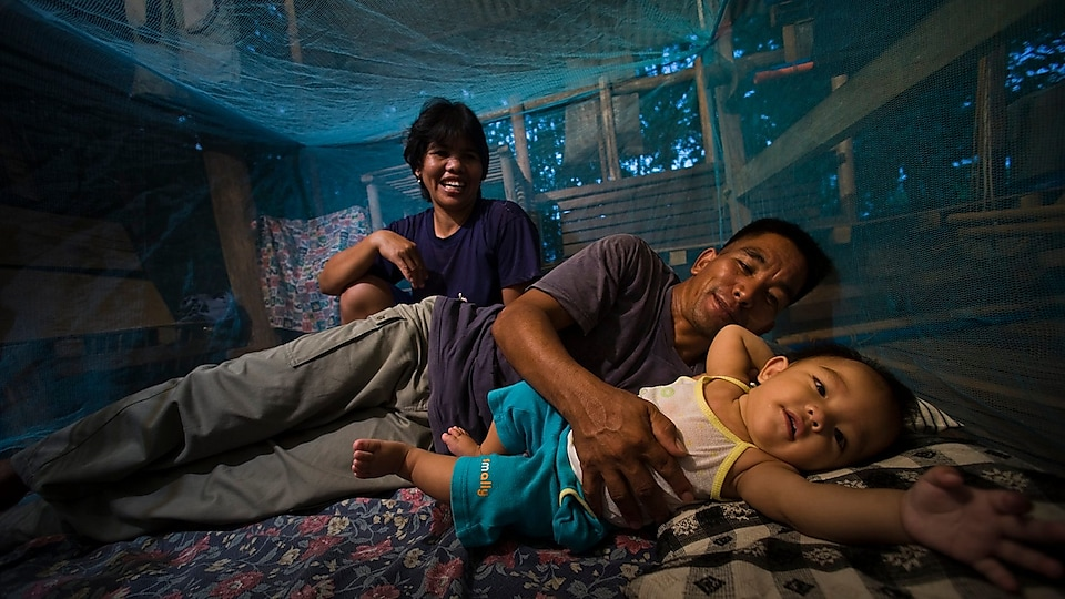 Family under a mosquito net