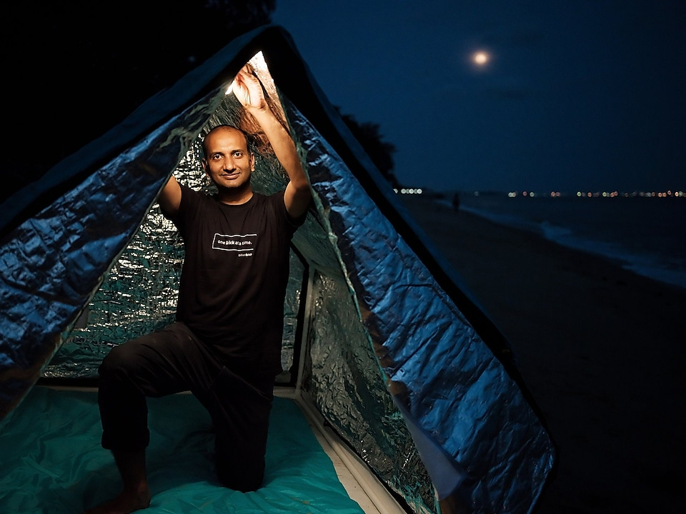 Prasoon Kumar under his easy-to-build tent Weatherhyde