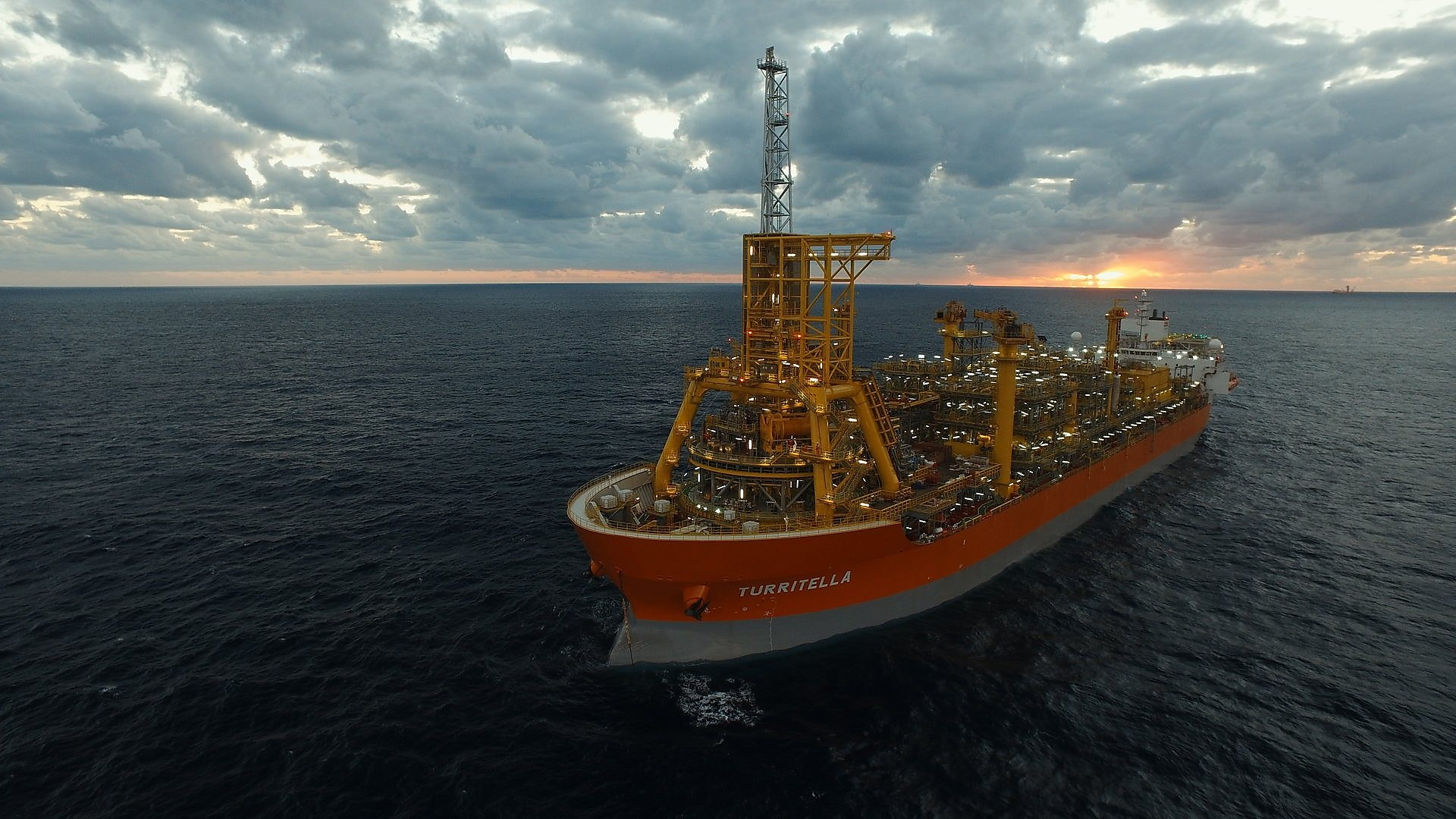 View of the floating production, storage and offloading vessel (FPSO) at sea.