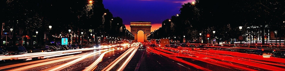 Paris, Arc de Triomphe and Champs-Élysées at night.