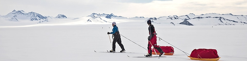 Rob Swan and his son walking through the snow in Antarctic expedition