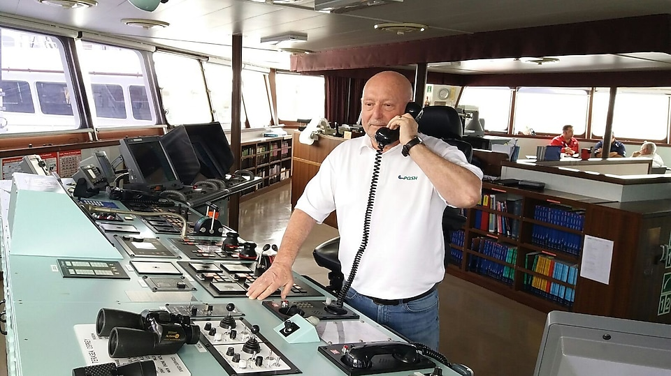 Captain Alan Stockwell on one of the tug boats pulling Prelude