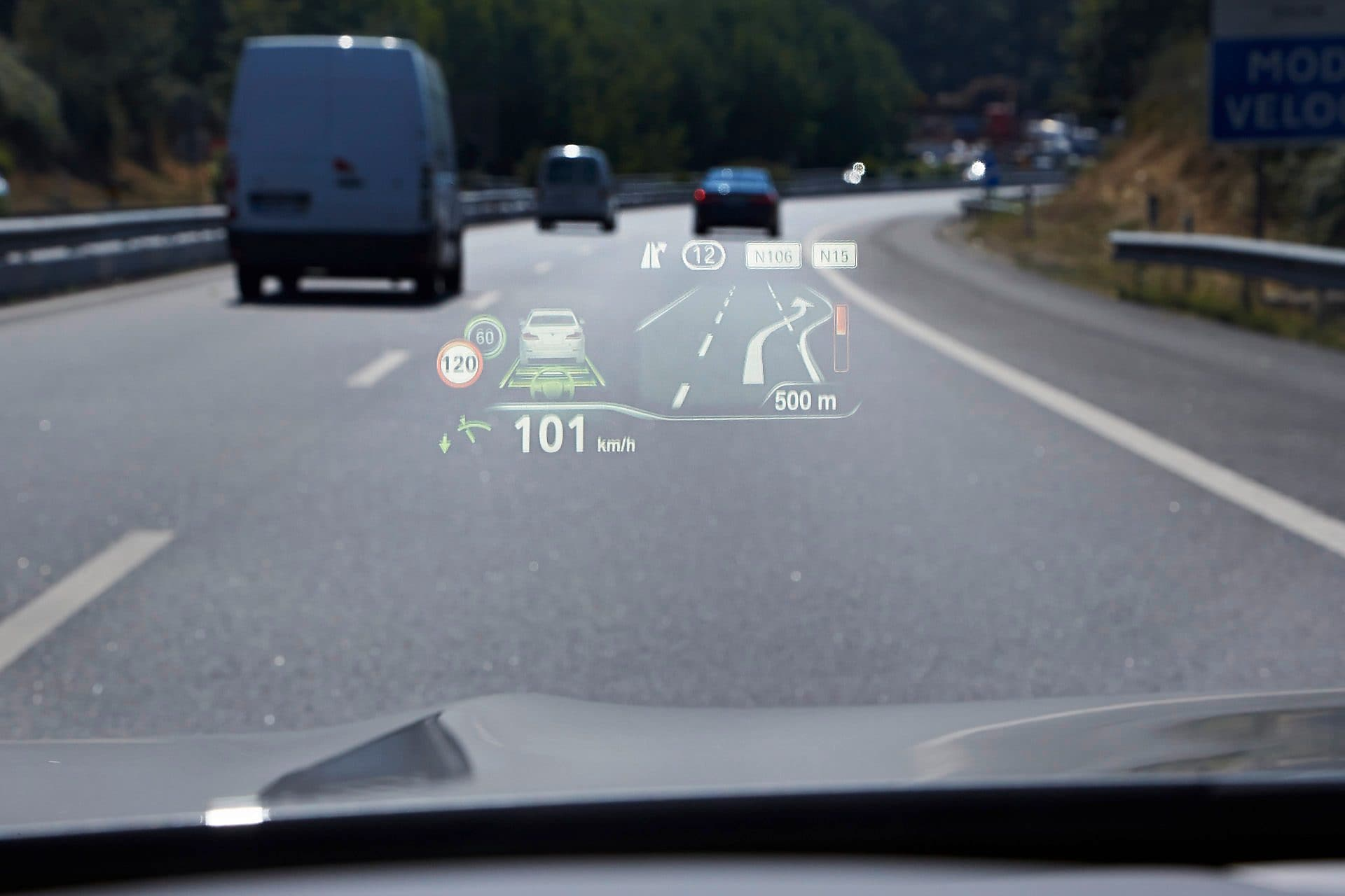 View from a car driving on a highway showing connected car technology on the windscreen