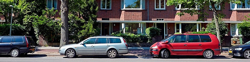 Cars parked outside houses in The Netherlands