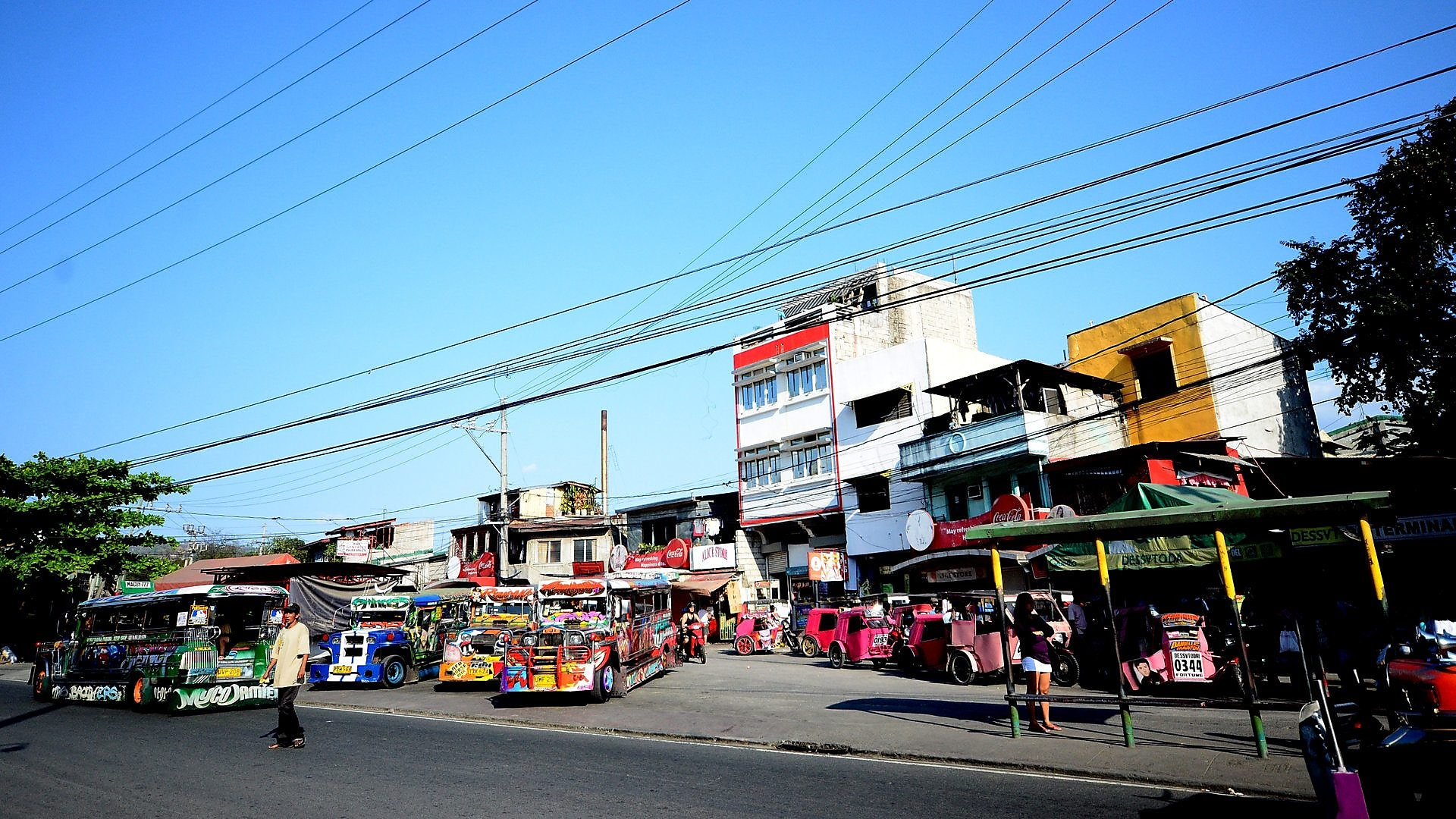 Marikina street scene featuring small local buses known as jeepneys