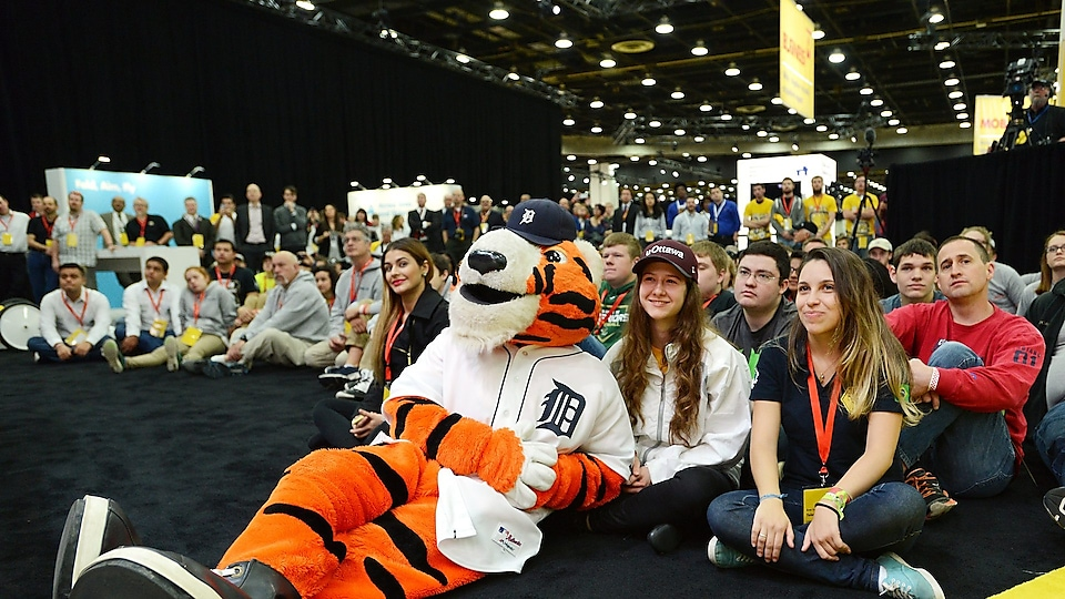 The mascot of the Tigers from Detroit enjoys the opening ceremony with the students.