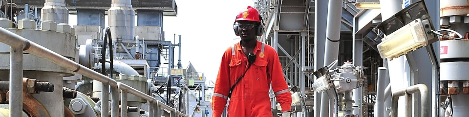 Engineer walking along an offshore platform in Nigeria