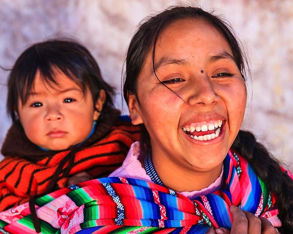 Peruvian woman with her baby on her back