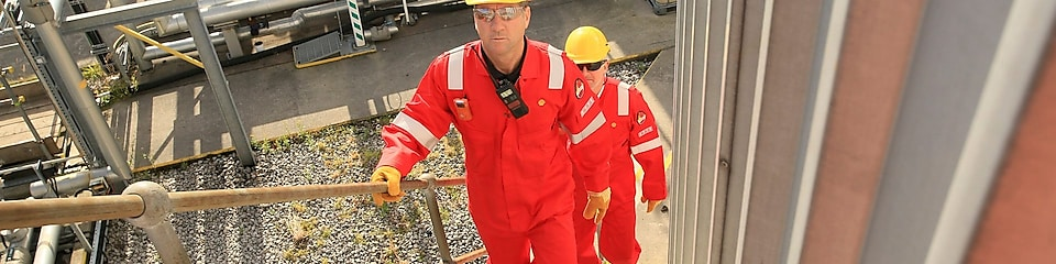 Shell engineers walking up stairway at a plant